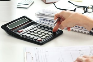 45107433 - close up of female accountant or banker making calculations. savings, finances and economy concept